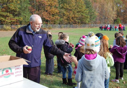 PPS Principal Jim Marshall encourages healthy eating at a 2011 school-wide celebration