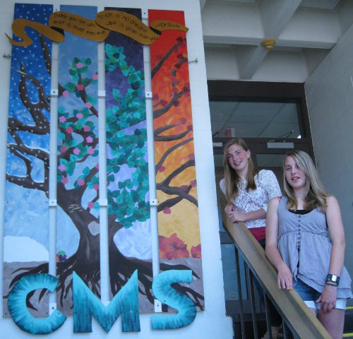 "CMS students with their artwork ""Four-Season Tree."" The pair worked on the piece nearly every day for four months."