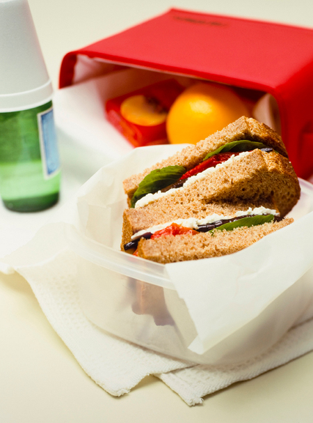 Packed lunched box, with veggie sandwich on whole wheat.