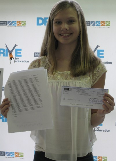 CMS student Sarah Mendl with her supporting essay that contributed to the award-winning grant proposal