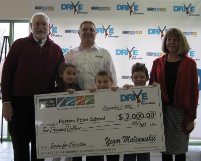 PPS Principal Jim Marshall accepting grant funding alongside his students in 2012