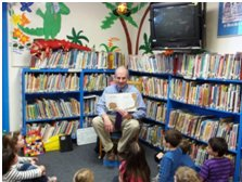 UMS Principal Antonicci reads to the students