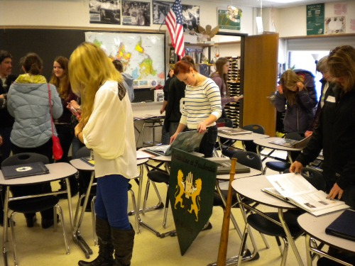 Ms. Gillard, Lindsay Henry, Hannah Rogers, and community members view projects