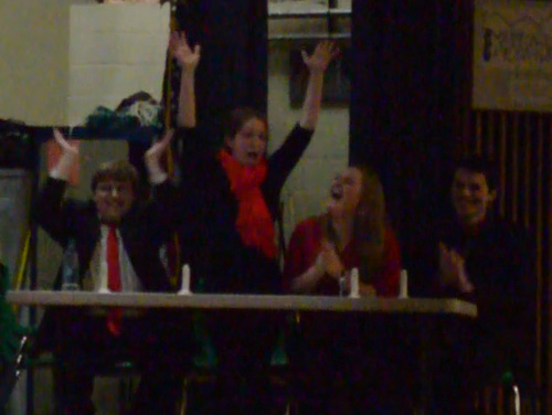 (Disclaimer: This photo is admittedly fuzzy but is too cute to omit.)  Kathleen McMahon reacts to her team's victory over the teachers' team