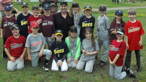 UMS Principal Chris Antonicci with students at the hit-a-thon event at Airport Park on May 11