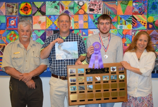 US Fish & Wildlife Service's David Frisque, CHS art teacher Vito Cannizzaro, Nick Bezio, and CHS art teacher Anne Cummings