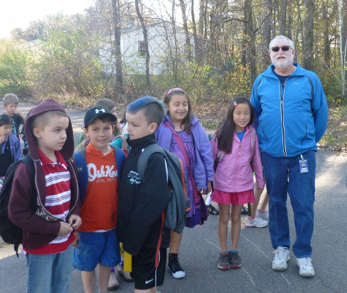 PPS Principal Marshall with a group of students at the May 3 walk-to-school event