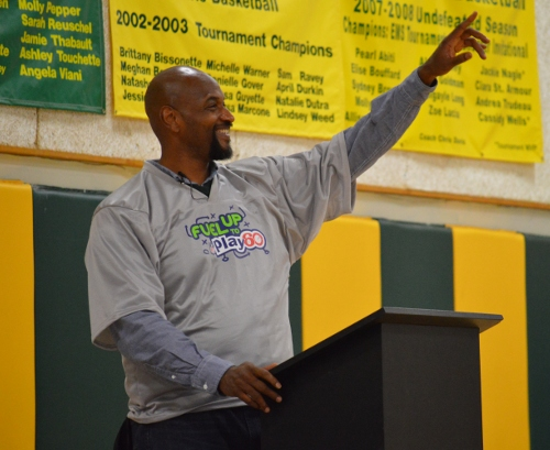 Lamar Mills talks with CMS students at the assembly