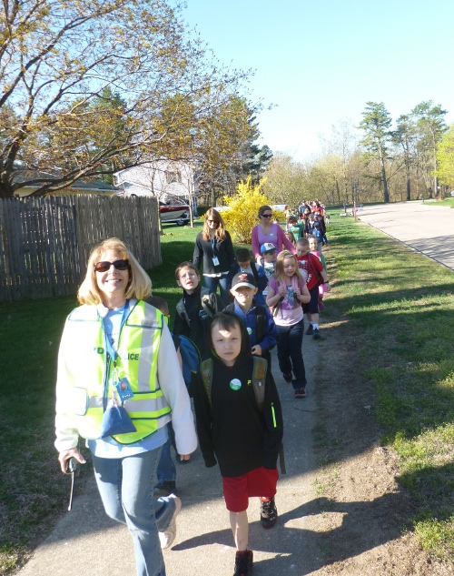 PPS kindergarten teacher Diane Trombley leads a group of students