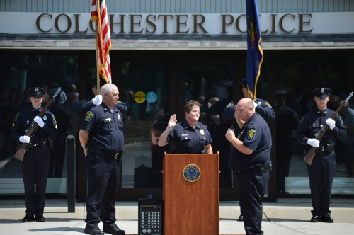 Colchester Police Department's Lieutenant Doug Allen swears in Chief Jennifer Morrison at the July 29 ceremony