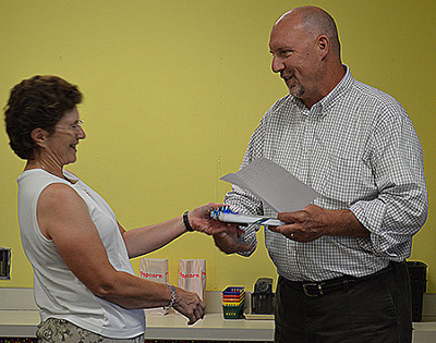 Superintendent Larry Waters presents Debbie Howard with a service award recognizing her forty years of service at Union Memorial School