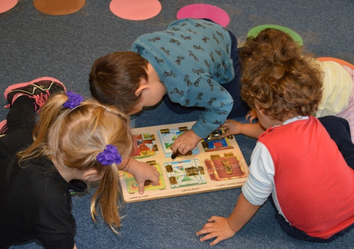 Children play together at the free playgroup at Malletts Bay School