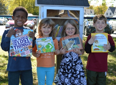 UMS students with the Colchester's first-ever Little Free Library