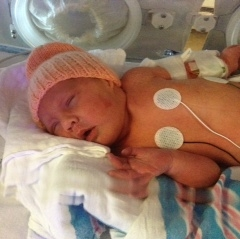 A newborn at Vermont Children's Hospital wears a knitted hat!