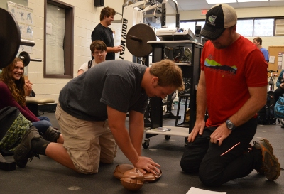 CHS PE teacher Morgan Samler works with a student in CPR training
