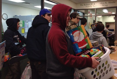 Members of the Lakers Hockey Team deliver toys to HowardCenter