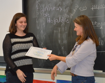 CHS sophomore Alex Gardner accepts her award from CHS Spanish teacher Carrie Robinson
