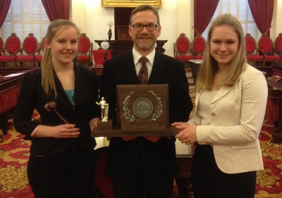 CHS students Lauren Hutchings and Summer Colley with Coach Bob Hall at the Vermont State House on March 10