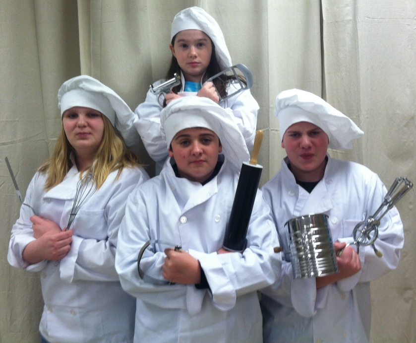 "CMS's Team TRRFCC—Makayla Benoit, Mikayla Groseclose, Adam William Henri Haglund, and Josh Porter—will compete in the March 22 Jr. Iron Chef Vermont competition. (For those unfamiliar with ""Iron Chef,"" the students are imitating the poses of the chefs in the internationally known program)"
