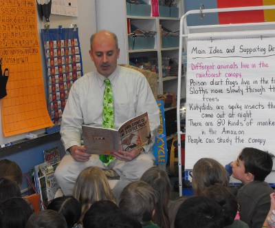 UMS Principal Chris Antonicci reads aloud to students as a special reward for their reading acheivements