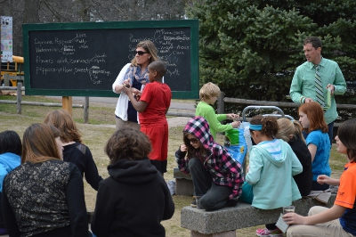 Malletts Bay School fourth-grade teacher Kate Ellingson instructs her students in the school's new outdoor classroom.