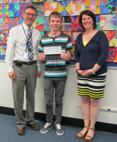 CHS's Bob Hall, junior Josh Wallis, and Principal Amy Minor with the $500 grant from NEFCU to support the Maker Club