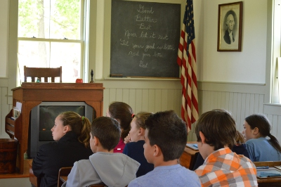 MBS students at the Old Log Schoolhouse at Airport Park