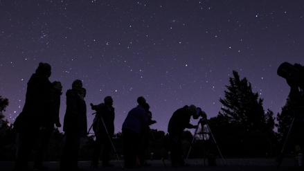 Visitors enjoying one of Bristol Astronomical Society's stargazing evenings at Tyntesfield, North Somerset.